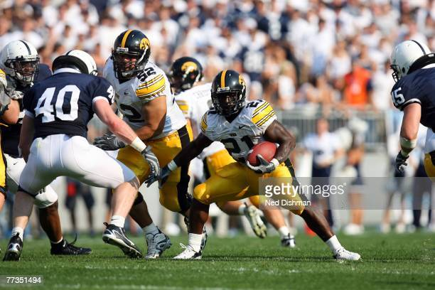 Running back Albert Young of the University of Iowa Hawkeyes runs with the ball during game against the Penn State Nittany Lions at Beaver Stadium on...