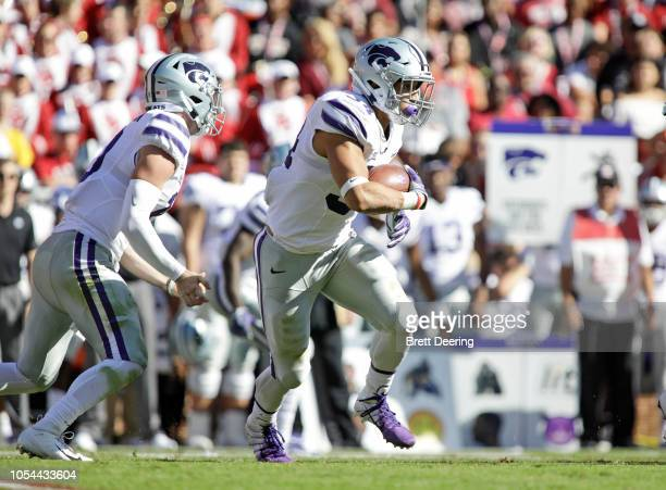 Running back Alex Barnes of the Kansas State Wildcats looks for an opening against the Oklahoma Sooners at Gaylord Family Oklahoma Memorial Stadium...