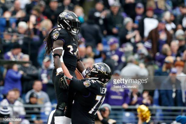 Running Back Alex Collins of the Baltimore Ravens and offensive guard Alex Lewis celebrate after a touchdown in the first quarter against the...