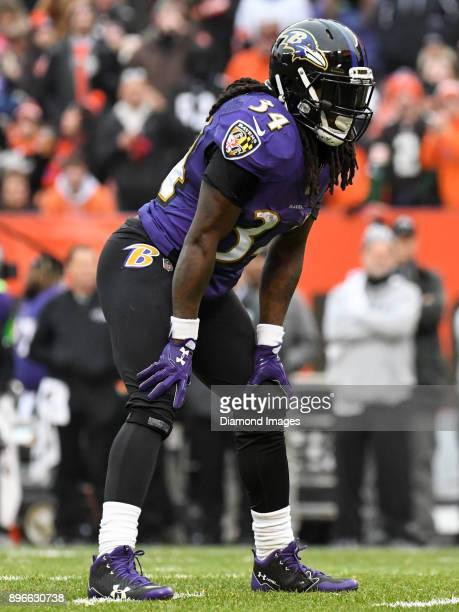 Running back Alex Collins of the Baltimore Ravens awaits the snap from his position in the second quarter of a game on December 17 2017 against the...