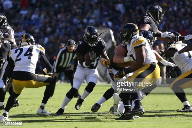 Running Back Alex Collins of the Baltimore Ravens carries the ball in the first quarter against the Pittsburgh Steelers at MT Bank Stadium on...