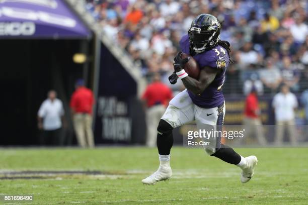 Running Back Alex Collins of the Baltimore Ravens carries the ball in the third quarter against the Chicago Bears at MT Bank Stadium on October 15...