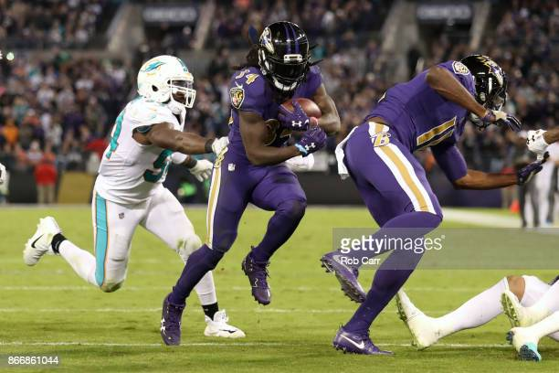 Running Back Alex Collins of the Baltimore Ravens carries the ball in the second quarter against the Miami Dolphins at MT Bank Stadium on October 26...