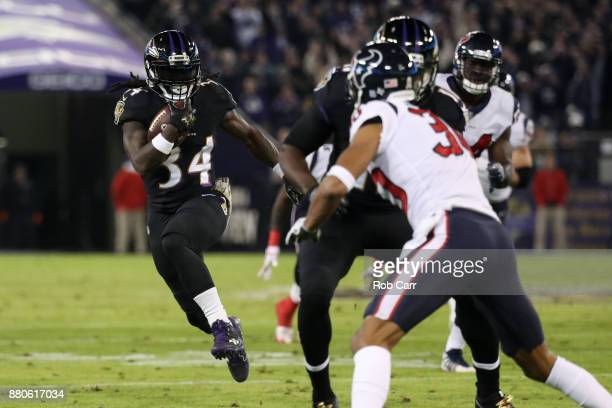 Running Back Alex Collins of the Baltimore Ravens carries the ball in the second quarter against the Houston Texans at MT Bank Stadium on November 27...