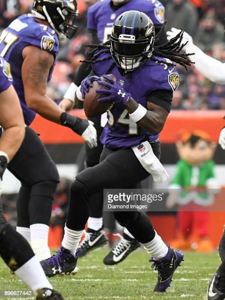 Running back Alex Collins of the Baltimore Ravens carries the ball in the second quarter of a game on December 17 2017 against the Cleveland Browns...