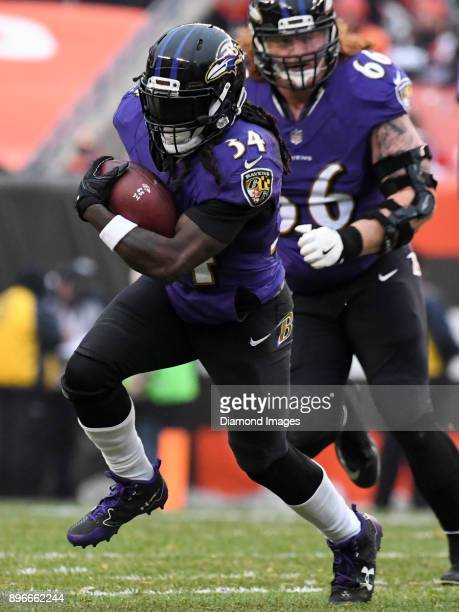 Running back Alex Collins of the Baltimore Ravens carries the ball in the third quarter of a game on December 17 2017 against the Cleveland Browns at...