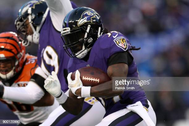Running Back Alex Collins of the Baltimore Ravens carries the ball in the first quarter against the Cincinnati Bengals at MT Bank Stadium on December...