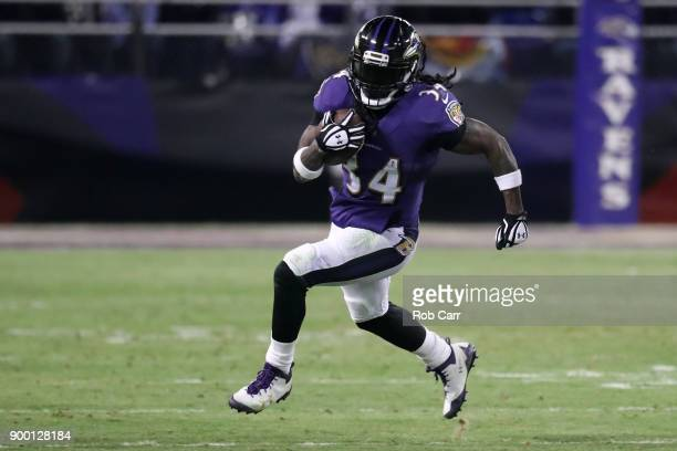 Running back Alex Collins of the Baltimore Ravens carries the ball in the third quarter against the Cincinnati Bengals at MT Bank Stadium on December...