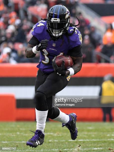Running back Alex Collins of the Baltimore Ravens carries the ball downfield in the third quarter of a game on December 17 2017 against the Cleveland...