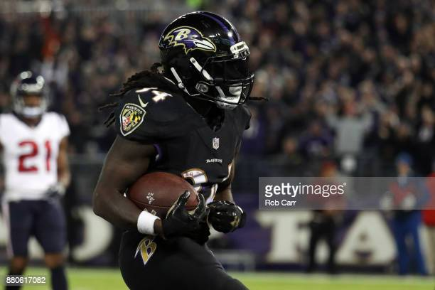 Running Back Alex Collins of the Baltimore Ravens celebrates a touchdown in the second quarter against the Houston Texans at MT Bank Stadium on...