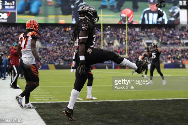 Running Back Alex Collins of the Baltimore Ravens celebrates after scoring a touchdown in the first quarter against the Cincinnati Bengals at MT Bank...