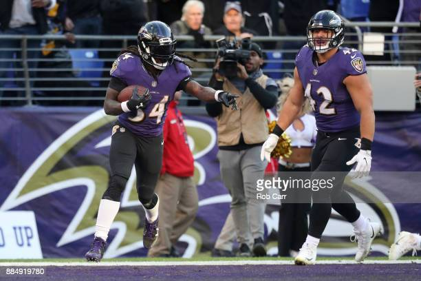 Running Back Alex Collins of the Baltimore Ravens celebrates after scoring a touchdown in the fourth quarter against the Detroit Lions at MT Bank...