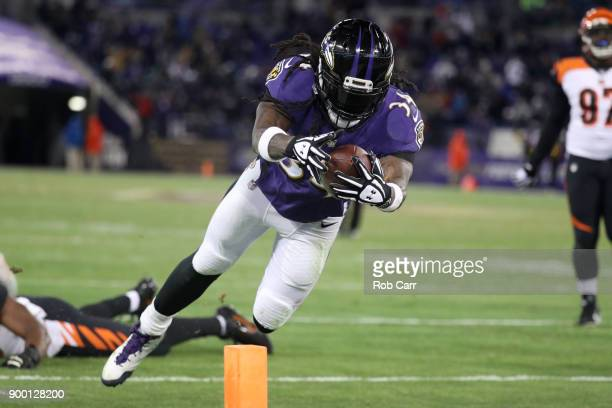 Running back Alex Collins of the Baltimore Ravens dives for a touchdown in the third quarter against the Cincinnati Bengals at MT Bank Stadium on...