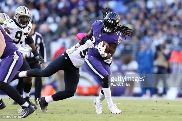 Running Back Alex Collins of the Baltimore Ravens is tackled as he carries the ball in the second quarter against the New Orleans Saints at MT Bank...