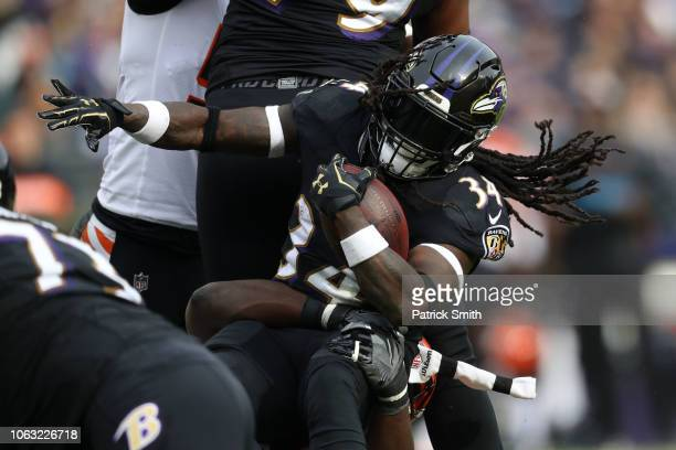 Running Back Alex Collins of the Baltimore Ravens is tackled as he carries the ball in the first quarter against the Cincinnati Bengals at MT Bank...