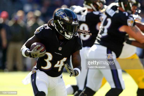 Running Back Alex Collins of the Baltimore Ravens runs with the ball in the first quarter against the Pittsburgh Steelers at MT Bank Stadium on...