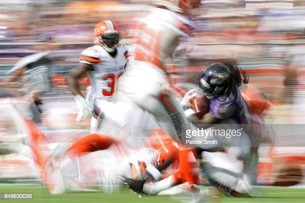 Running back Alex Collins of the Baltimore Ravens rushes against the Cleveland Browns in the second half at MT Bank Stadium on September 17 2017 in...