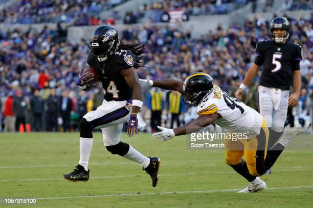 Running Back Alex Collins of the Baltimore Ravens rushes for a touchdown in the third quarter against the Pittsburgh Steelers at MT Bank Stadium on...