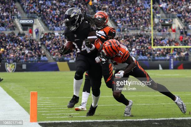 Running Back Alex Collins of the Baltimore Ravens rushes for a touchdown in the first quarter against the Cincinnati Bengals at MT Bank Stadium on...