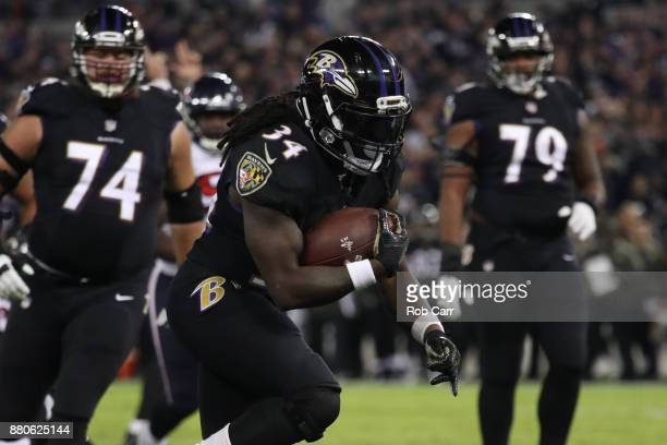 Running Back Alex Collins of the Baltimore Ravens rushes for a touchdown in the second quarter against the Houston Texans at MT Bank Stadium on...