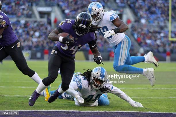 Running Back Alex Collins of the Baltimore Ravens rushes for a touchdown in the fourth quarter against the Detroit Lions at MT Bank Stadium on...