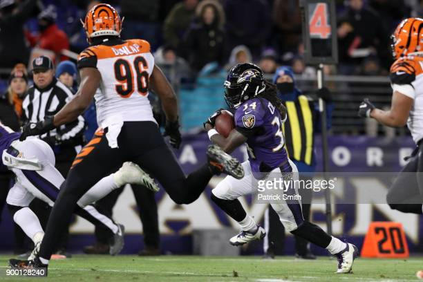 Running Back Alex Collins of the Baltimore Ravens rushes for a touchdown in the third quarter against the Cincinnati Bengals at MT Bank Stadium on...