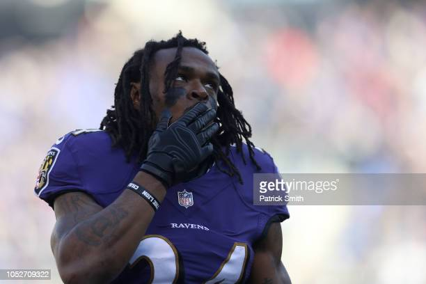 Running Back Alex Collins of the Baltimore Ravens stands on the field prior to the game against the New Orleans Saints at MT Bank Stadium on October...