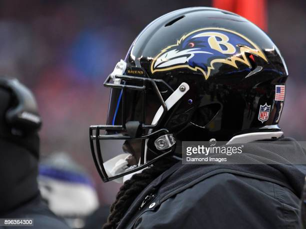 Running back Alex Collins of the Baltimore Ravens watches the action from the sideline in the first quarter of a game on December 17 2017 against the...