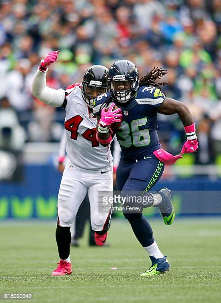 Running back Alex Collins of the Seattle Seahawks is pursued by linebacker Vic Beasley of the Atlanta Falcons at CenturyLink Field on October 16 2016...