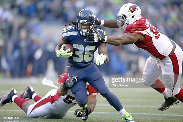 Running back Alex Collins of the Seattle Seahawks rushes against the Arizona Cardinals at CenturyLink Field on December 24 2016 in Seattle Washington