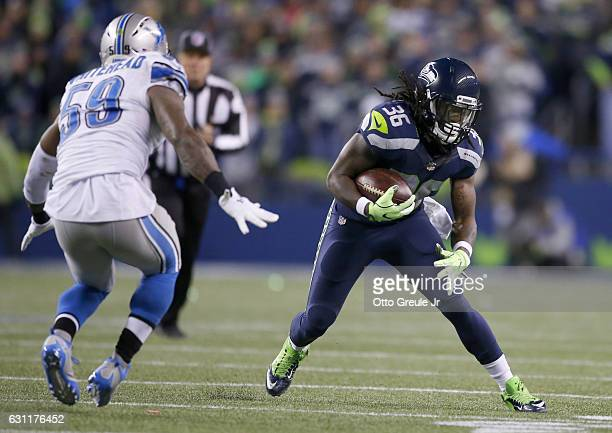 Running back Alex Collins of the Seattle Seahawks rushes against the Detroit Lions in the NFC Wild Card game at CenturyLink Field on January 7 2017...