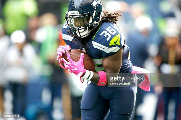 Running back Alex Collins of the Seattle Seahawks warms up before facing the Atlanta Falcons at CenturyLink Field on October 16 2016 in Seattle...