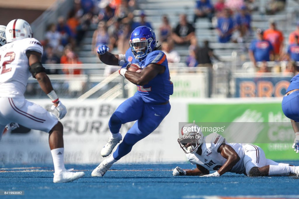 Running back Alexander Mattison #22 of the Boise State Broncos plows through a hole during second half action against the Troy Trojans on September 2, 2017 at Albertsons Stadium in Boise, Idaho. Boise State won the game 24-13.