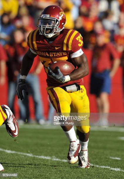 Running back Alexander Robinson of the Iowa State Cyclones rushes for yards in the first half of play against the Oklahoma State Cowboys at Jack...