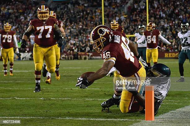 Running back Alfred Morris of the Washington Redskins scores a first quarter touchdown against the defense of free safety Malcolm Jenkins of the...