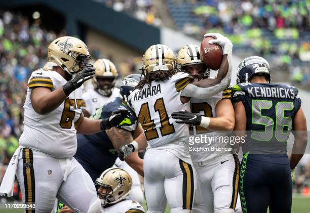 Running back Alvin Kamara of the New Orleans Saints celebrates with running back Zach Line and offensive lineman Larry Warford after scoring a...