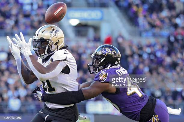 Running Back Alvin Kamara of the New Orleans Saints fumbles the ball in the first quarter against the Baltimore Ravens at M&T Bank Stadium on October...
