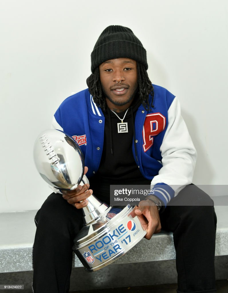 NFL running back Alvin Kamara of the New Orleans Saints poses with the 2017 Pepsi NFL Rookie of the Year trophy on February 1, 2018 in Bloomington, Minnesota.