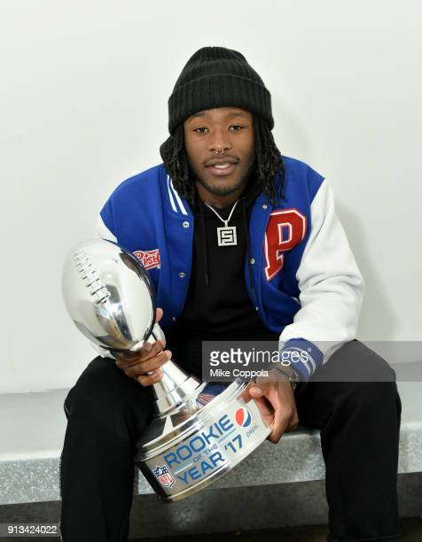 NFL running back Alvin Kamara of the New Orleans Saints poses with the 2017 Pepsi NFL Rookie of the Year trophy on February 1 2018 in Bloomington...