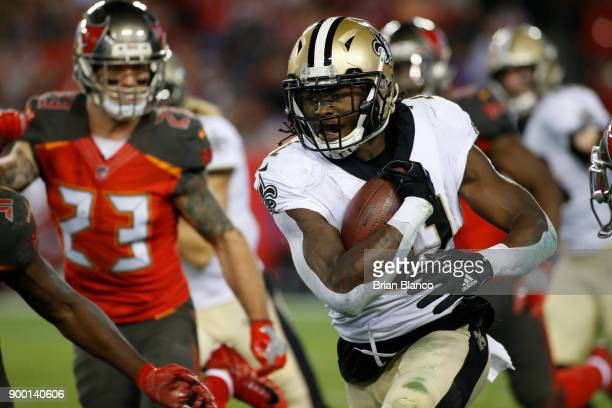 Running back Alvin Kamara of the New Orleans Saints runs for a first down during the fourth quarter of an NFL football game against the Tampa Bay...