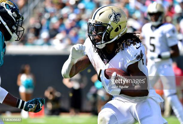 Running back Alvin Kamara of the New Orleans Saints runs with the ball during the second quarter of the game against the Jacksonville Jaguars at TIAA...