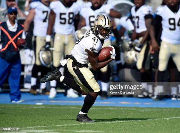 Running back Alvin Kamara of the New Orleans Saints rushes for a touchdown against the Los Angeles Chargers during the first half of a preseason...