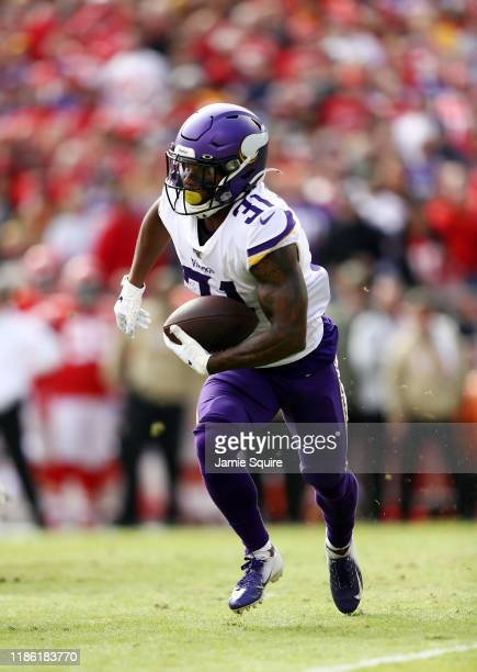 Running back Ameer Abdullah of the Minnesota Vikings carries the ball during the game against the Kansas City Chiefs at Arrowhead Stadium on November...