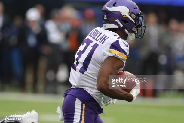 Running Back Ameer Abdullah of the Minnesota Vikings has a short gain against the New York Giants during the second half at MetLife Stadium on...
