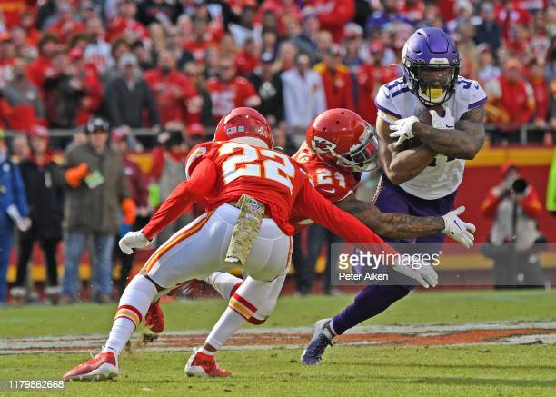 Running back Ameer Abdullah of the Minnesota Vikings rushes up field against strong safety Jordan Lucas and free safety Juan Thornhill of the Kansas...