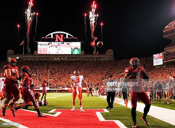 Running back Ameer Abdullah of the Nebraska Cornhuskers celebrates a touchdown during their game at against the Illinois Fighting Illini Memorial...