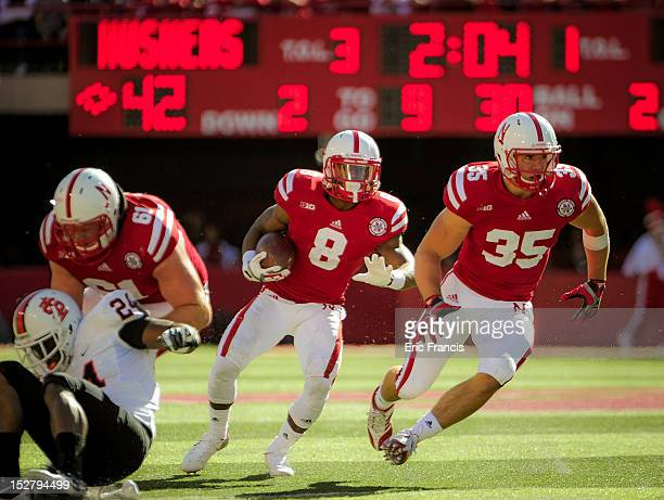 Running back Ameer Abdullah of the Nebraska Cornhuskers follows teammate fullback Andy Janovich during their game at Memorial Stadium on September 22...