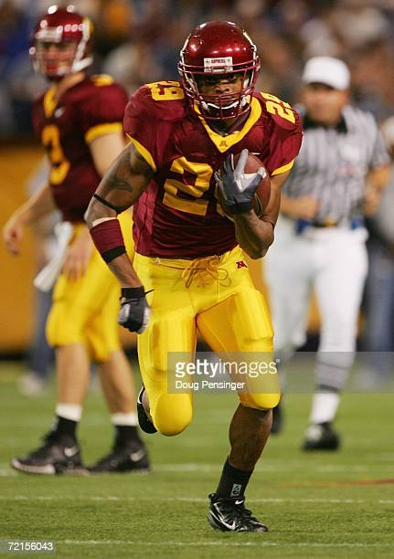 Running back Amir Pinnix the Minnesota Golden Gophers rushes with the ball during the game against the Penn State Nittany Lions on October 7, 2006 at...