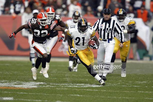 Running back Amos Zereoue of the Pittsburgh Steelers gets loose persued by Devin Bush of the Cleveland Browns during the NFL game at Cleveland Browns...