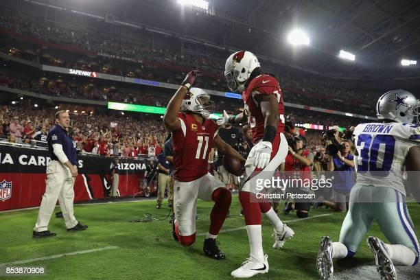 Running back Andre Ellington of the Arizona Cardinals and wide receiver Larry Fitzgerald react after scoring a 15 yard touchdown during the third...